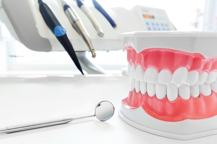 Should You Choose Dentures or Implants?